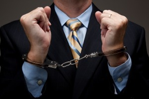Business man in handcuffs